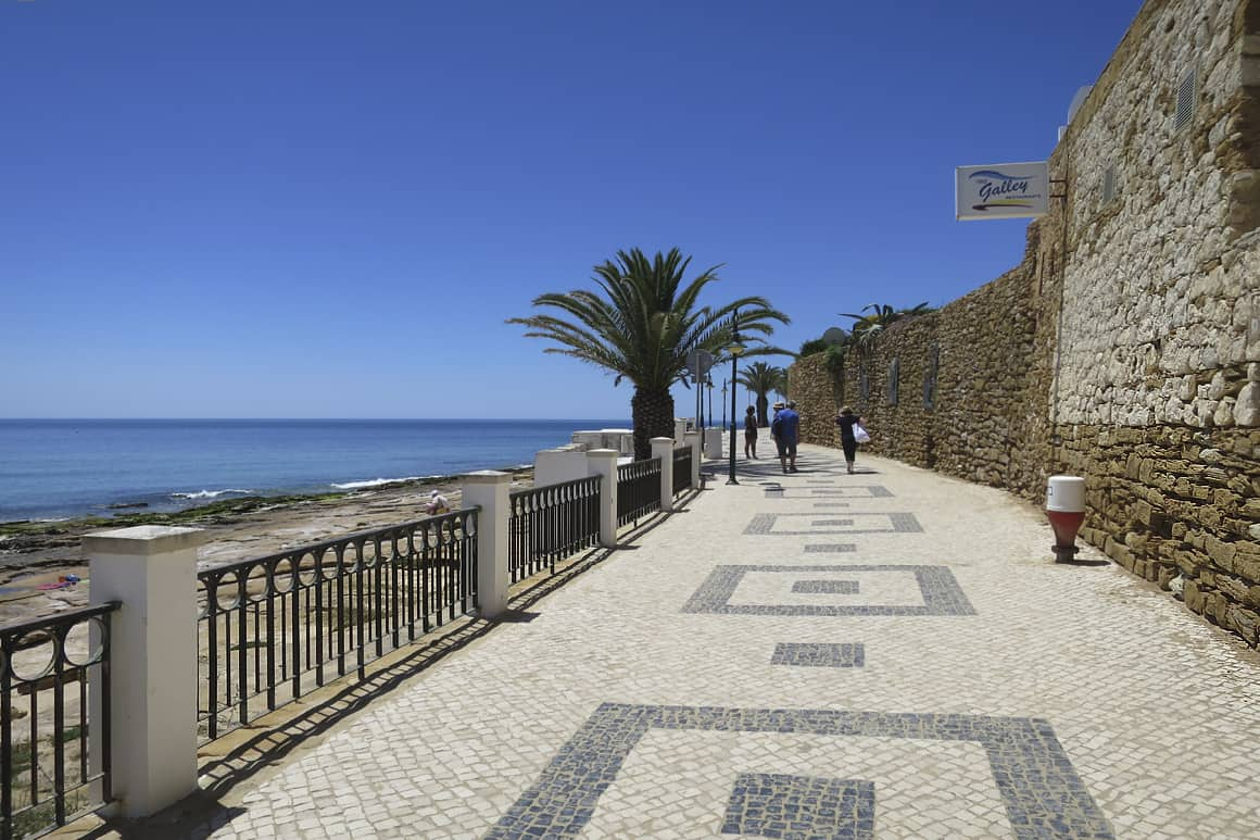 Paved Promenade with Palm Trees beside Luz Beach